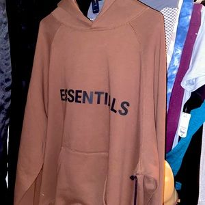 Brown Essential Pullover. Never worn